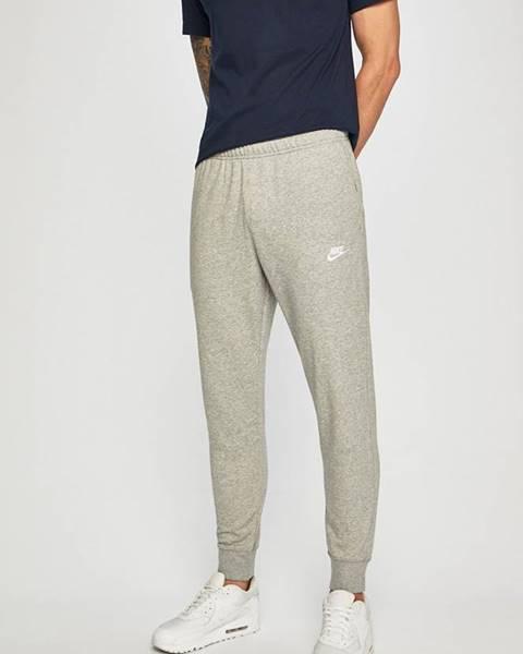 Šedé kalhoty Nike Sportswear